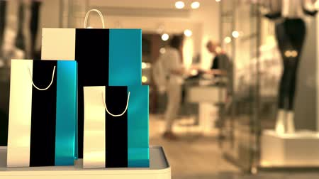 estonya : Flag of Estonia on the paper shopping bags against blurred store entrance. Retail related clip