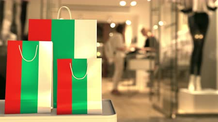 búlgaro : Flag of Bulgaria on the paper shopping bags against blurred store entrance. Retail related clip