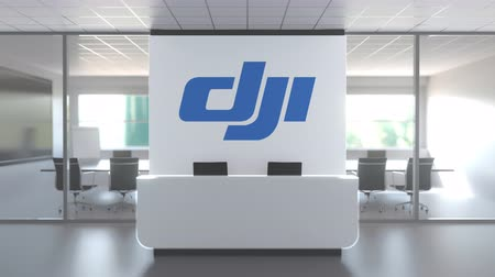 oficial : Logo of SZ DJI TECHNOLOGY CO., LTD on a wall in the modern office, editorial conceptual 3D animation