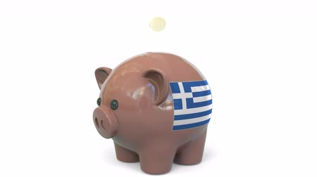 penny : Putting money into piggy bank with flag of Greece. Tax system system or savings related conceptual 3D animation Stock Footage