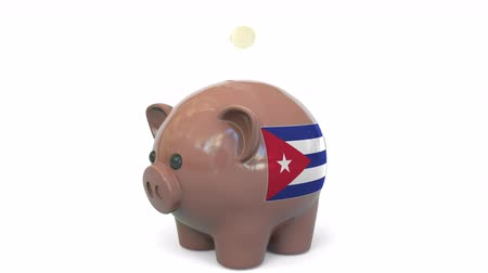 penny : Putting money into piggy bank with flag of Cuba. Tax system system or savings related conceptual 3D animation Stock Footage