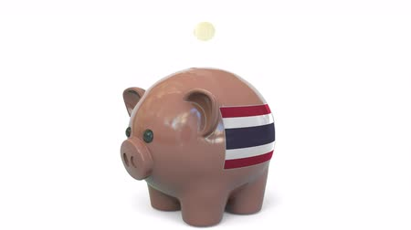 penny : Putting money into piggy bank with flag of Thailand. Tax system system or savings related conceptual 3D animation