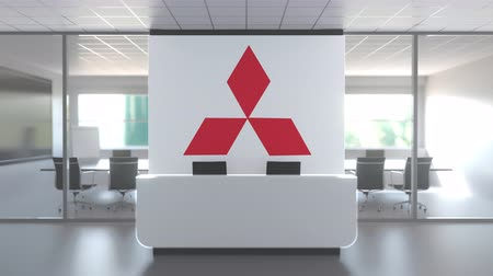 oficial : MITSUBISHI logo above reception desk in the modern office, editorial conceptual 3D animation Vídeos