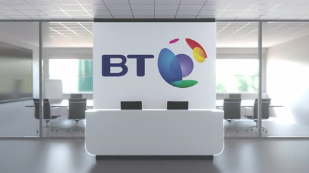 oficial : BT GROUP logo above reception desk in the modern office, editorial conceptual 3D animation