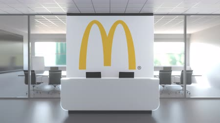 mcdonalds : MCDONALDS logo above reception desk in the modern office, editorial conceptual 3D animation