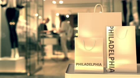 retailer : Shopping bags with PHILADELPHIA text against blurred store. American shopping related clip