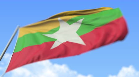 mastro de bandeira : Waving national flag of Myanmar, low angle view. Loopable realistic slow motion 3D animation