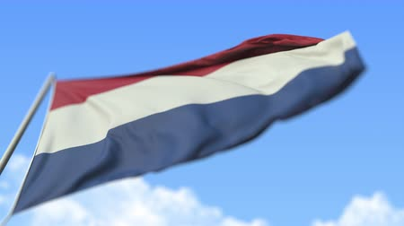 aşağıda : Waving national flag of the Netherlands, low angle view. Loopable realistic slow motion 3D animation