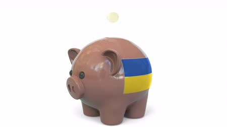 penny : Putting money into piggy bank with flag of Ukraine. Tax system system or savings related conceptual 3D animation