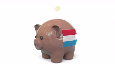 centavo : Putting money into piggy bank with flag of Luxembourg. Tax system system or savings related conceptual 3D animation