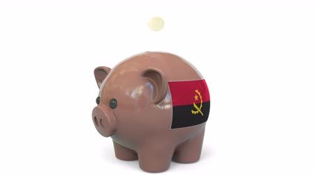 centavo : Putting money into piggy bank with flag of Angola. Tax system system or savings related conceptual 3D animation Stock Footage