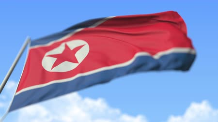 aşağıda : Waving national flag of North Korea, low angle view. Loopable realistic slow motion 3D animation