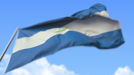 nicaraguan : Waving national flag of Nicaragua, low angle view. Loopable realistic slow motion 3D animation