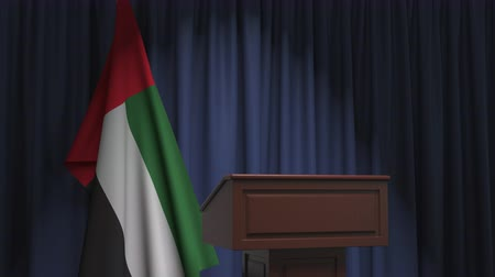 press conference : Flag of the United Arab Emirates UAE and speaker podium tribune. Political event or statement related conceptual 3D animation