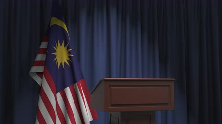 political speech : National flag of Malaysia and speaker podium tribune. Political event or statement related conceptual 3D animation