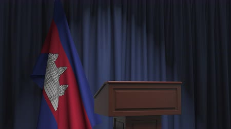 press conference : Flag of Cambodia and speaker podium tribune. Political event or statement related conceptual 3D animation