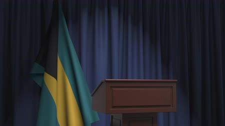podyum : Flag of Bahamas and speaker podium tribune. Political event or statement related conceptual 3D animation