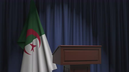 discurso : Flag of Algeria and speaker podium tribune. Political event or statement related conceptual 3D animation
