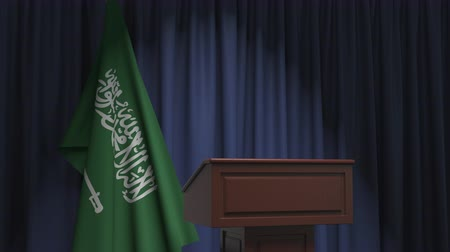podyum : National flag of Saudi Arabia and speaker podium tribune. Political event or statement related conceptual 3D animation