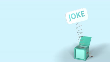проворный : Jack-in-the-box with JOKE text on the popping plate. 3D animation Стоковые видеозаписи