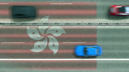 navigasyon : Aerial top down view of cars revealing flag of Hong Kong on the road. Traveling related conceptual 3D animation