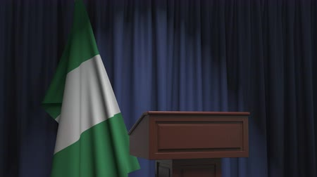 nigeria flag : National flag of Nigeria and speaker podium tribune. Political event or statement related conceptual 3D animation