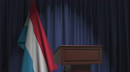 political speech : National flag of Luxembourg and speaker podium tribune. Political event or statement related conceptual 3D animation