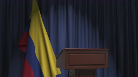 press conference : Flag of Colombia and speaker podium tribune. Political event or statement related conceptual 3D animation Stock Footage