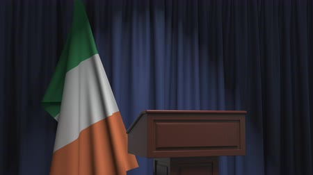political speech : Flag of the Republic of Ireland and speaker podium tribune. Political event or statement related conceptual 3D animation