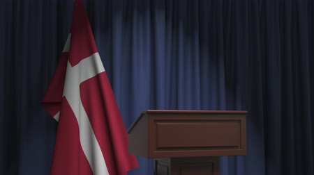 press conference : Flag of Denmark and speaker podium tribune. Political event or statement related conceptual 3D animation Stock Footage