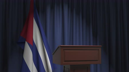 podyum : Flag of Cuba and speaker podium tribune. Political event or statement related conceptual 3D animation Stok Video