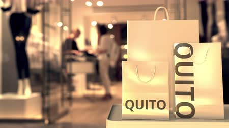 quito : Paper bags with Quito text. Shopping in Ecuador related 3D animation