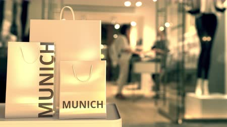 münchen : Paper bags with Munich text. Shopping in Germany related 3D animation