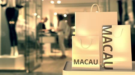 showcase : Bags with Macau text. Shopping in China related 3D animation Stock Footage