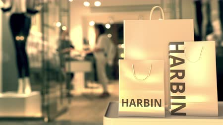 harbin : Bags with Harbin text. Shopping in China related conceptual 3D animation