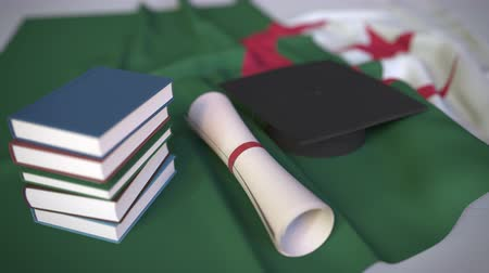 mortarboard : Graduation cap, books and diploma on the Algerian flag. Higher education in Algeria related conceptual 3D animation