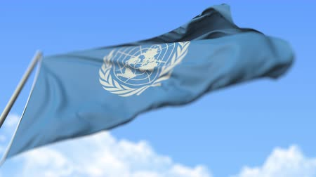 peacekeeping : Flying flag of the United Nations UN, low angle view. Editorial loopable realistic slow motion 3D animation