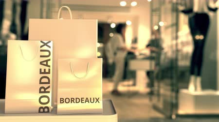 bordeaux : Paper bags with Bordeaux text. Shopping in France related conceptual 3D animation
