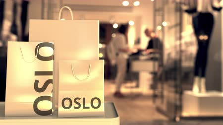 norveç : Shopping bags with Oslo text. Shopping in Norway related conceptual 3D animation