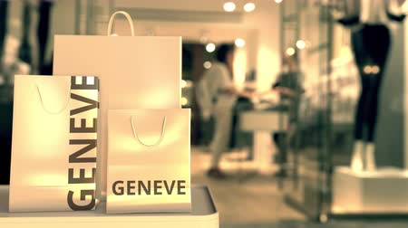 showcase : Shopping bags with Geneve caption against blurred store entrance. Shopping in Switzerland related 3D animation Stock Footage