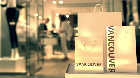 Ванкувер : Bags with Vancouver text. Shopping in Canada related 3D animation