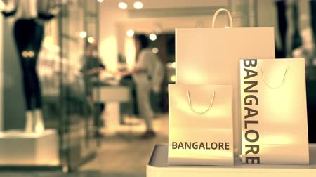 bangalore : Shopping bags with Bangalore text. Shopping in India related conceptual 3D animation Stock Footage