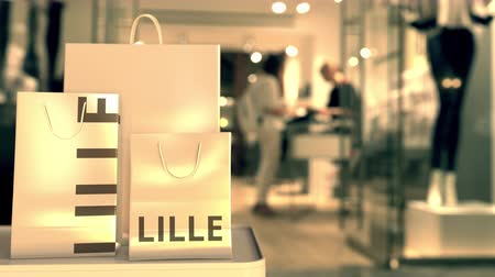 キャプション : Shopping bags with Lille caption against blurred store entrance. Shopping in France related 3D animation