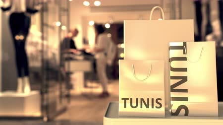tunesie : Shopping bags with Tunis text. Shopping in Tunisia related 3D animation Stockvideo