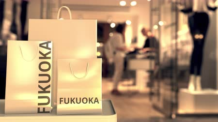 vetrina : Shopping bags with Fukuoka text. Shopping in Japan related 3D animation Filmati Stock