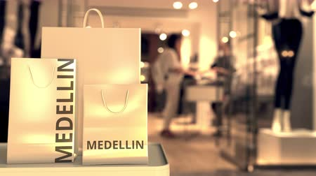 colômbia : Paper bags with Medellin text. Shopping in Colombia related conceptual 3D animation