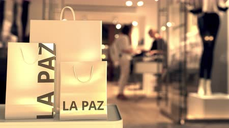Боливия : Bags with La paz text. Shopping in Bolivia related conceptual 3D animation