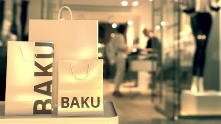 baku : Bags with Baku text. Shopping in Azerbaijan related 3D animation Stock Footage