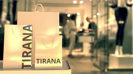 showcase : Paper bags with Tirana text. Shopping in Albania related conceptual 3D animation Stock Footage