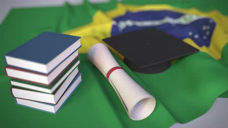 brazil : Graduation cap, books and diploma on the Brazilian flag. Higher education in Brazil related conceptual 3D animation